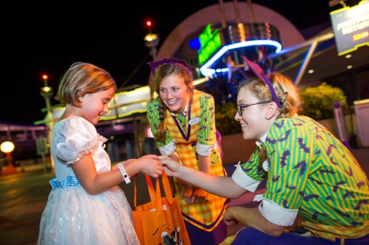 "Kids of all ages get into the Happy Halloween spirit while trick-or-treating during MickeyÕs Not-So-Scary Halloween Party at the Magic Kingdom. The family-friendly after-hours event also offers dance parties, meet and greets with favorite characters in costume, plus the must-see ""Mickey's Boo-to-You Halloween Parade"" and ""Happy HalloWishes"" fireworks display. Mickey's Not-So-Scary Halloween Party is a special ticket event and takes place on select nights each fall at Walt Disney World Resort in Lake Buena Vista, Fla. (Ali Nasser, photographer)"