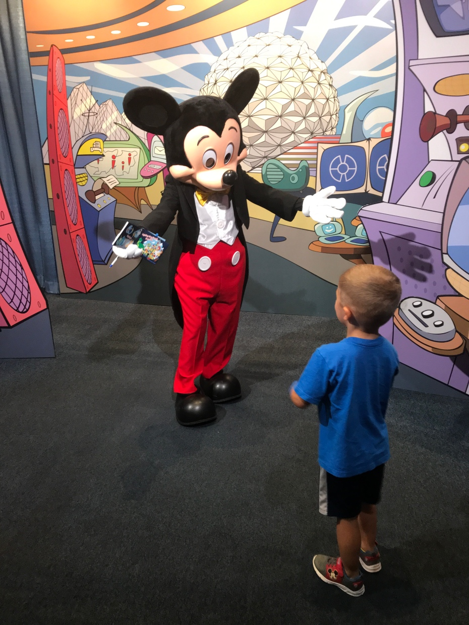 283881e13939b ... that stands out in my mind is my son's first encounters with Mickey –  he was lucky enough to meet him THREE times on our trip, and he loved every  one: